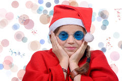 Little girl in red santa hat on white background Stock Photography