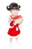 Little girl in red santa suit on white background. Stock Images