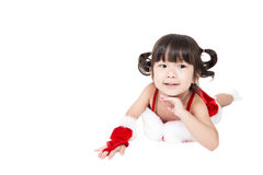 Little girl in red santa suit on white background. Royalty Free Stock Images