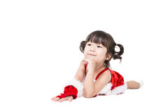 Little girl in red santa suit on white background. Royalty Free Stock Photo