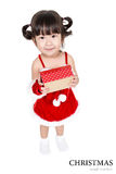 Little girl in red santa suit on white background. Royalty Free Stock Photography