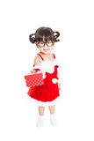 Little girl in red santa suit on white background. Stock Photos