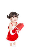 Little girl in red santa suit on white background. Royalty Free Stock Photos