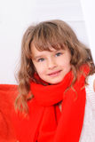 Little girl in red scarf. Cute little girl in red scarf indoors Royalty Free Stock Photo