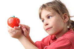 Little girl in red shirt holding kitchen timer Royalty Free Stock Photos