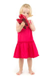 Little girl in red shoes Stock Photos