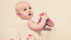 Little girl with red shoes Royalty Free Stock Image