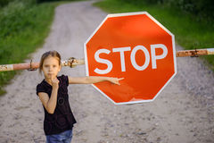 Little girl about red sign Stock Photo
