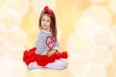 The little girl in the red skirt. Royalty Free Stock Photo
