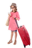 Little girl with a red suitcase talking on phone Royalty Free Stock Photo