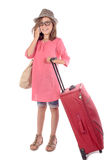 Little girl with a red suitcase talking on phone Stock Image