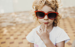 Little girl in red sunglasses, Stock Images