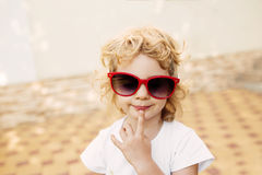 Little girl in red sunglasses, Royalty Free Stock Image
