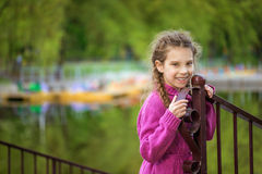 Little girl in red sweater near Royalty Free Stock Image