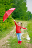 Little girl with red umbrella Royalty Free Stock Photography