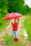 Little girl with red umbrella Royalty Free Stock Images