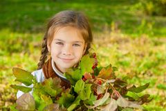 Little girl with red viburnum Royalty Free Stock Images
