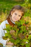 Little girl with red viburnum Stock Images