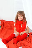 Little girl in red and white indoors Royalty Free Stock Photo