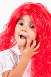 Little girl with red wigs Royalty Free Stock Photography