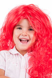 Little girl with red wigs Royalty Free Stock Photo