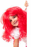 Little girl with red wigs Royalty Free Stock Images