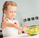 Little girl refuses to eat salad Stock Photos
