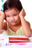 Little girl refusing to brush her teeth Royalty Free Stock Image