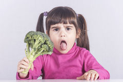 Little girl refusing to eat her vegetables Royalty Free Stock Photos
