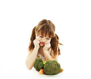 Little Girl Refusing Vegetables Royalty Free Stock Image
