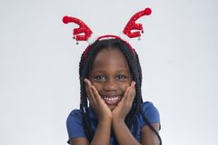 Little girl with Reindeer Ear. Excited African-American little girl with Reindeer Ear celebrating Christmas Season stock photography
