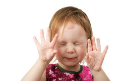 Little girl reject or play hide-and-seek. Expression activity childhood stock photos