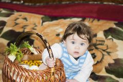 Little girl rejoices at the festive basket royalty free stock photography
