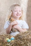 Little girl rejoices little bunny Royalty Free Stock Images