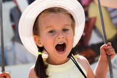 Little girl rejoices. Little girl shouting for joy. Shallow depth of field Royalty Free Stock Photo