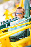 Little girl relaxing in colorful chair at beach Royalty Free Stock Photography
