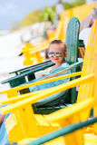 Little girl relaxing in colorful chair at beach Stock Photography