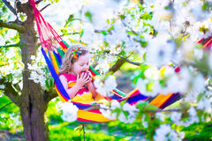 Little girl relaxing in a hammock Stock Images