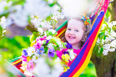 Little girl relaxing in a hammock Royalty Free Stock Photo
