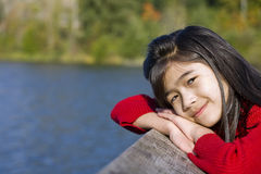 Little girl relaxing by lake Royalty Free Stock Photography