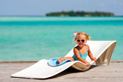 Little girl relaxing in tropic ocean background Royalty Free Stock Images