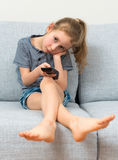 Little girl with remote control. Royalty Free Stock Photography