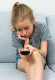 Little girl with remote control. Stock Photography