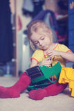 Little girl repairing a toy truck with a screwdriver Stock Image