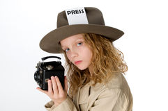 Little Girl Reporter. Little girl in reporter costume holding antique camera Stock Photo