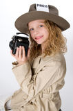 Little Girl Reporter. Little girl in reporter costume holding antique camera Royalty Free Stock Image