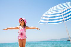 Little girl at the resort on the sea Stock Photos