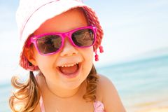 Little girl at resort on sea Royalty Free Stock Photos