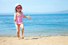 Little girl at resort on sea Stock Photography