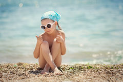 Little girl resting on the beach Royalty Free Stock Photos